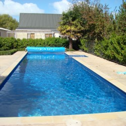 Concrete Pool After-Painted in Dark Blue